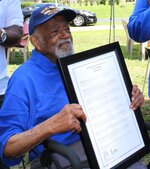 WWII Army veteran Louis F. Martin's receives a proclamation from Phi Beta Sigma Fraternity, Inc. during his 104 birthday celebration in Chesterfield, Va., on July 3, 2021.  (Kristi K. Higgins/The Progress-Index via AP)