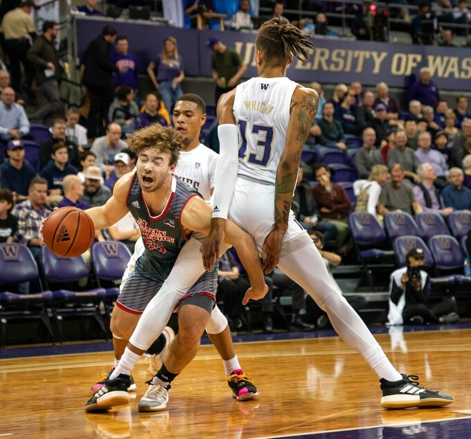 Washington's Hameir Wright (13) defends against Eastern Washington's Ellis Magnuson and is called for a foul during the first half of an NCAA college basketball game Wednesday, Dec. 4, 2019, in Seattle. (Dean Rutz/The Seattle Times via AP)