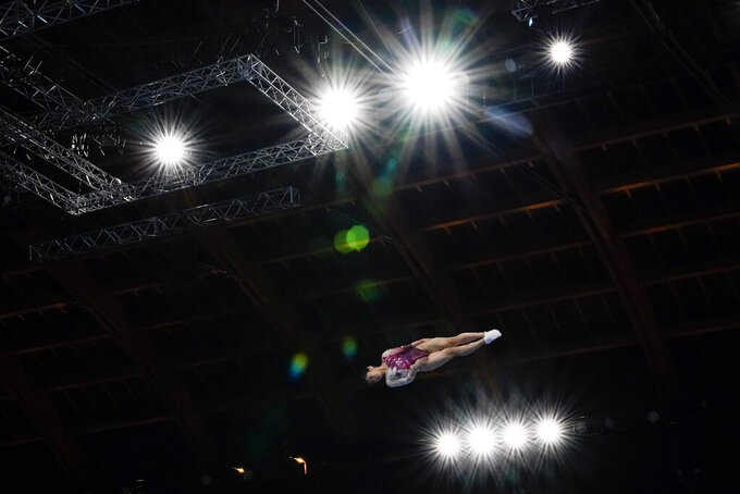 Megu Uyama, of Japan, competes in the women's trampoline gymnastics final at the 2020 Summer Olympics, Friday, July 30, 2021, in Tokyo. (AP Photo/Ashley Landis)