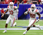 Mississippi running back Scottie Phillips (22) runs for a touchdown as quarterback Jordan Ta'amu (10) signals during the first half of a college football game against Texas Tech , Saturday, Sept. 1, 2018, in Houston. (AP Photo/Eric Christian Smith)
