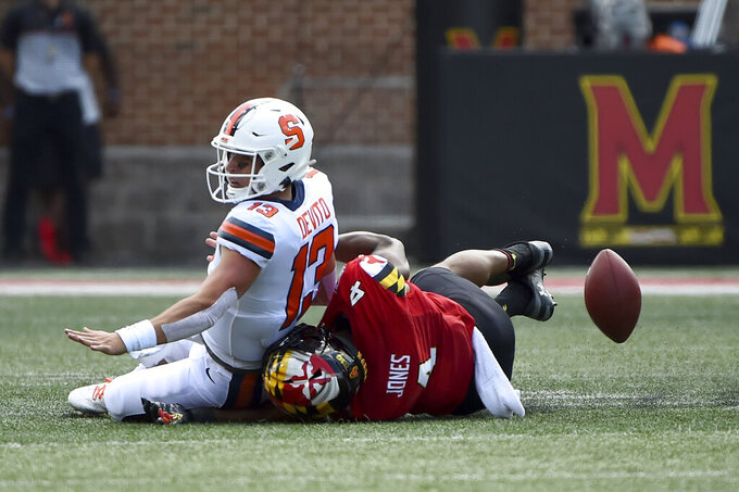Maryland Terrapins linebacker Keandre Jones (4) forces Syracuse Orange quarterback Tommy DeVito (13) to fumble during the first half of an NCAA college football game, Saturday, Sept. 7, 2019, in College Park, Md. (AP Photo/Will Newton)