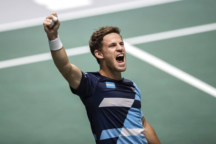 Argentina's Diego Schwartzman celebrates after beating Chile's Cristian Garin during their Davis Cup tennis match in Madrid, Spain, Tuesday, Nov. 19, 2019. (AP Photo/Bernat Armangue)