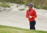 Justin Rose, of England, hits out of a bunker on the 11th hole during a practice round for the U.S. Open Golf Championship, Wednesday, June 13, 2018, in Southampton, N.Y. (AP Photo/Carolyn Kaster)