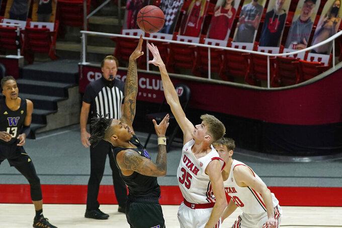 Washington forward Nate Roberts shoots over Utah center Branden Carlson (35) during the first half during an NCAA college basketball game Thursday, Dec. 3, 2020, in Salt Lake City. (AP Photo/Rick Bowmer)