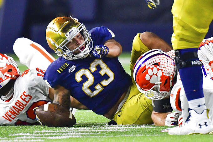 Notre Dame running back Kyren Williams (23) points after being tackled during the fourth quarter against Clemson in an NCAA college football game Saturday, Nov. 7, 2020, in South Bend, Ind. (Matt Cashore/Pool Photo via AP)