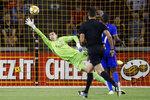 Atlanta United goalkeeper Przemyslaw Tyton is scored on by Atlanta United forward Josef Martinez in the second half of an MLS soccer match, Wednesday, Sept. 18, 2019, in Cincinnati. (AP Photo/John Minchillo)