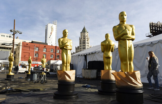 Oscar statues stand outside Hollywood Boulevard in preparation for Sunday's 92nd Academy Awards at the Dolby Theatre, Wednesday, Feb. 5, 2020, in Los Angeles. (AP Photo/Chris Pizzello)