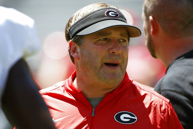 FILE - In this Aug. 17, 2019, file photo, Georgia coach Kirby Smart looks on during warm ups for an NCAA football preseason scrimmage in Athens, Ga. Georgia coach Kirby Smart says quarterback is the position most affected by spring practice being canceled by the coronavirus pandemic. It's bad timing for the Bulldogs, who would have used the spring as a time to have Wake Forest transfer Jamie Newman and others compete to replace three-year starter Jake Fromm. (Joshua L. Jones/Athens Banner-Herald via AP, File)/Athens Banner-Herald via AP)