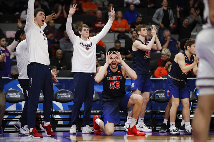 Liberty players celebrate during the second half against Mississippi State in a first-round game in the NCAA men's college basketball tournament Friday, March 22, 2019, in San Jose, Calif. (AP Photo/Ben Margot)