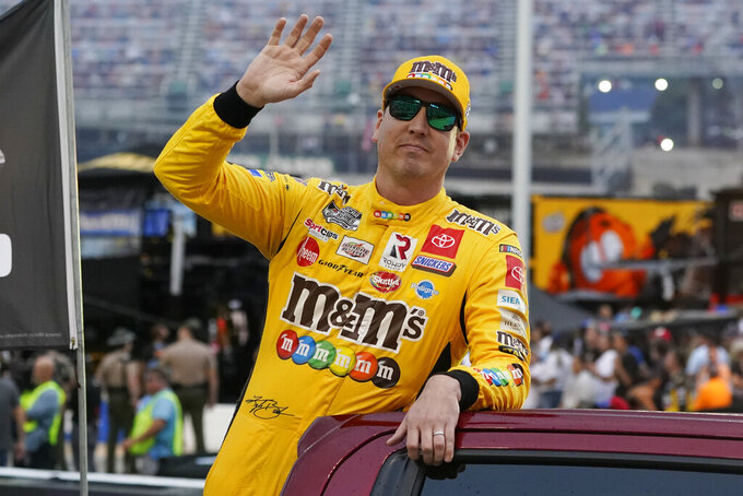 Kyle Busch waves to fans before a NASCAR Cup Series auto race at Bristol Motor Speedway Saturday, Sept. 18, 2021, in Bristol, Tenn. (AP Photo/Mark Humphrey)
