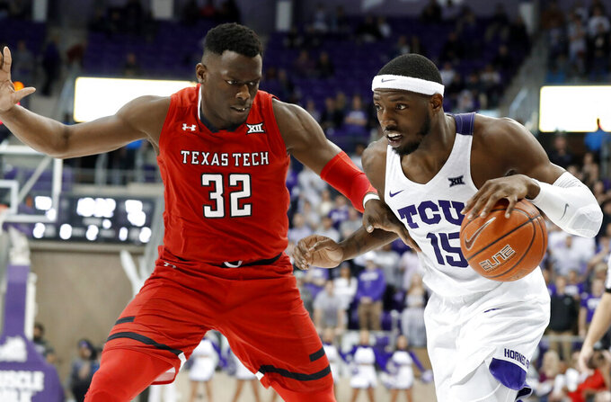 Texas Tech center Norense Odiase (32) defends as TCU forward JD Miller (15) works to the basket in the second half of an NCAA college basketball game in Fort Worth, Texas, Saturday, March 2, 2019. Miller scored a game high 18 points in the 81-66 loss to Texas Tech. (AP Photo/Tony Gutierrez)