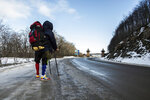 """Venezuelan Yeslie Aranda, 57, stands at the entrance of Ushuaia, Argentina, the southernmost city in the world, as he makes good on his promise to travel throughout South America with one leg and a prosthesis, Saturday, Aug. 17, 2019. """"I am living my dream,"""" Aranda said, as he headed toward a sign that welcomes visitors to 'the end of the world.' """"My message to people is to pursue their own dreams, and conquer them as well."""" (AP Photo/Luján Agusti)"""