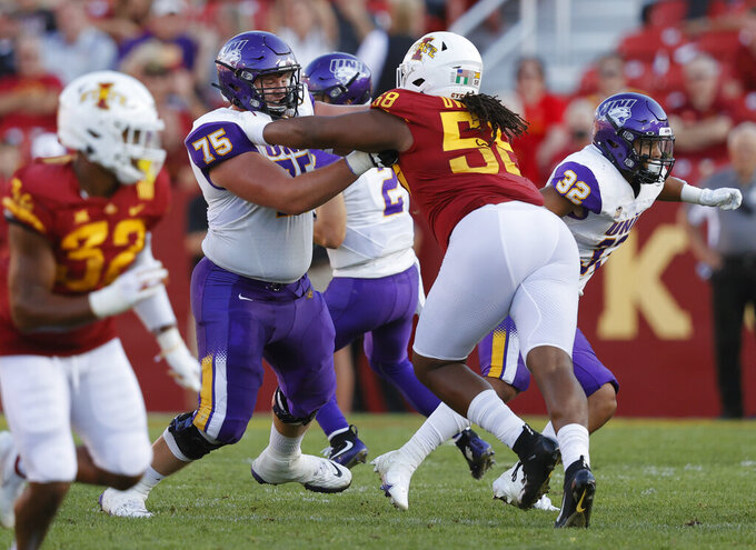 Northern Iowa offensive lineman Jared Penning (75) holds off Iowa State defensive end Eyioma Uwazurike (58) during the second half of an NCAA college football game, Saturday, Sept. 4, 2021, in Ames, Iowa. Iowa State won 16-10. (AP Photo/Matthew Putney)