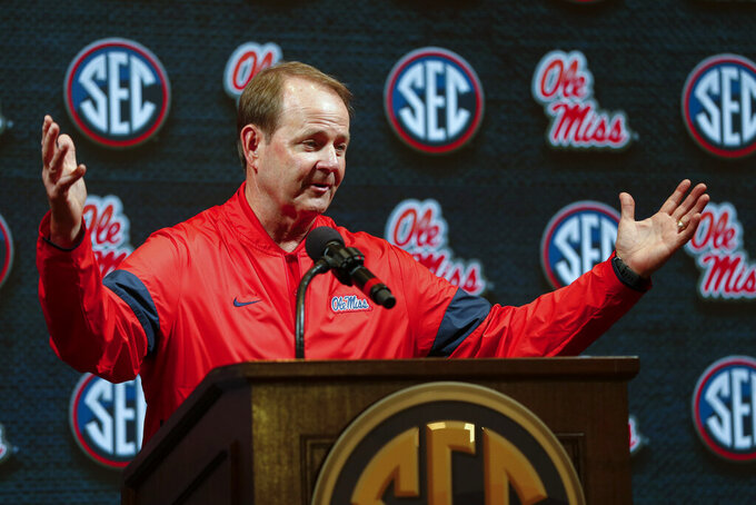 Mississippi coach Kermit Davis speaks during the Southeastern Conference NCAA college basketball media day Wednesday, Oct. 16, 2019, in Birmingham, Ala. (AP Photo/Butch Dill)