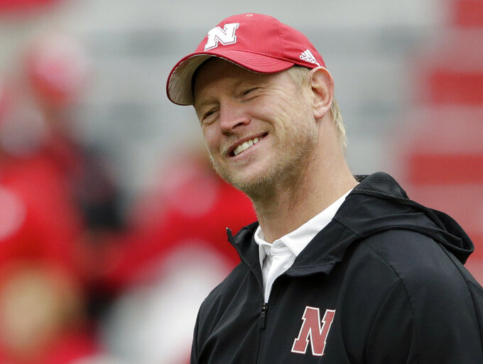FILE - In this Sept. 29, 2018, file photo, Nebraska head coach Scott Frost smiles while talking with Purdue head coach Jeff Brohm, not shown, before an NCAA college football game in Lincoln, Neb. Good times are coming are coming at Nebraska, coach Scott Frost promises. It may not happen this weekend against No. 16 Wisconsin. But while the Cornhuskers don't have any wins yet under the first-year coach, he does have hope. (AP Photo/Nati Harnik, File)