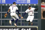Houston Astros shortstop Carlos Correa (1) and center fielder George Springer (4) celebrate the team's 3-1 win over Tampa Bay Rays in Game 2 of a baseball American League Division Series in Houston, Saturday, Oct. 5, 2019. (AP Photo/Michael Wyke)