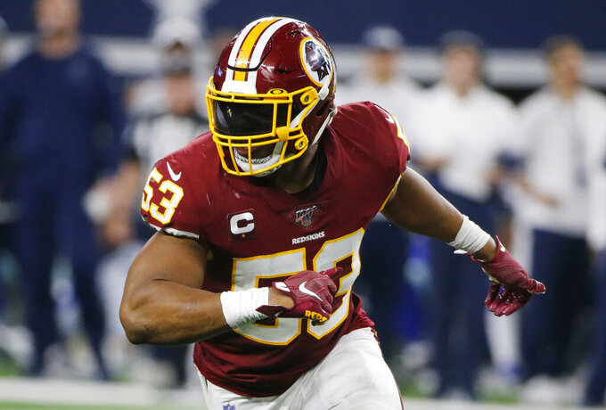 FILE - In this Dec. 15, 2019, file photo, Washington Redskins inside linebacker Jon Bostic (53) during the second half of an NFL football game against the Dallas Cowboys in Arlington, Texas. A person with knowledge of the move tells The Associated Press the Redskins have agreed to re-sign inside Bostic to a $6.6 million, two-year deal. (AP Photo/Michael Ainsworth, File)