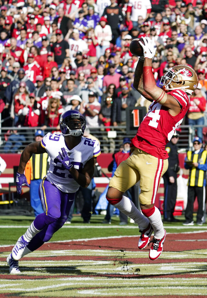 San Francisco 49ers wide receiver Kendrick Bourne (84) catches a pass for a touchdown in front of Minnesota Vikings cornerback Xavier Rhodes (29) during the first half of an NFL divisional playoff football game, Saturday, Jan. 11, 2020, in Santa Clara, Calif. (AP Photo/Tony Avelar)