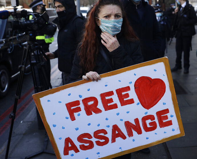 A Julian Assange supporter reacts outside the Westminster Magistrates Court after Julian Assange was denied bail at a hearing in the court in London, Wednesday, Jan. 6, 2021. On Monday Judge Vanessa Baraitser ruled that Julian Assange cannot be extradited to the US. because of concerns about his mental health. Assange had been charged under the US's 1917 Espionage Act for