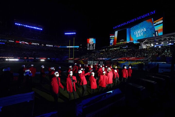 Dancers perform during the halftime show of the NFL Super Bowl 55 football game between the Kansas City Chiefs and Tampa Bay Buccaneers, Sunday, Feb. 7, 2021, in Tampa, Fla. (AP Photo/Ashley Landis)