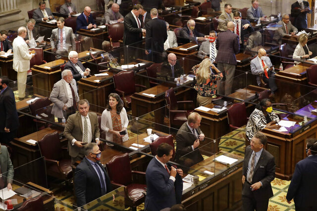 House members prepare to leave the chamber on the first day of a special session Monday, Aug. 10, 2020, in Nashville, Tenn. The special session was called by Tennessee Gov. Bill Lee to pass liability reforms to protect businesses from lawsuits prompted by reopening after the coronavirus quarantine. (AP Photo/Mark Humphrey)