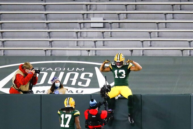 Green Bay Packers' Allen Lazard celebrates his touchdown catch during the first half of an NFL football game against the Chicago Bears Sunday, Nov. 29, 2020, in Green Bay, Wis. (AP Photo/Matt Ludtke)