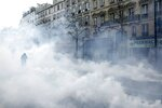 Teargas fills the street during minor clashes between protestors and police in Paris, Saturday, March 23, 2019. The French government vowed to strengthen security as yellow vest protesters stage a 19th round of demonstrations, in an effort to avoid a repeat of last week's riots in Paris. (AP Photo/Kamil Zihnioglu)