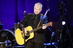 "FILE — In this Sept. 11, 2019, file photo, John Prine performs at the Americana Honors & Awards show in Nashville, Tenn. The icon earned two posthumous Grammy nominations, including best American Roots performance and best American Roots song for ""I Remember Everything."