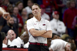 FILE - In this Jan. 18, 2020, file photo, Arkansas coach Eric Musselman reacts after a call during the second half of an NCAA college basketball game against Kentucky in Fayetteville, Ark. College coaches endured a tense time waiting for for the NCAA to green light the 2020 basketball season. They knew there was a window the NCAA was looking at to start the season, likely sometime in late November or early December. They just didn't have an exact date. So they did the best they could to prepare for the big moment, yet still found themselves in a scramble once it actually happened.(AP Photo/Michael Woods, File)