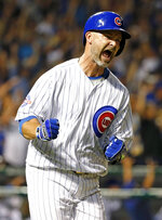 FILE- In this Sept. 25, 2016, file photo, Chicago Cubs' David Ross reacts as he rounds the bases after hitting a solo home run during the fifth inning of a baseball game against the St. Louis Cardinals in Chicago. The Cubs have hired former catcher David Ross to replace Joe Maddon as their manager, hoping he can help them get back to the playoffs after missing out for the first since 2014. (AP Photo/Nam Y. Huh, File)