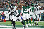 Philadelphia Eagles' Kenneth Gainwell (14) celebrates after scoring a touchdown as New York Jets' Elijah Campbell (26) reacts during the first half of an NFL preseason football game Friday, Aug. 27, 2021, in East Rutherford, N.J. (AP Photo/John Minchillo)