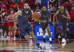 Nevada's Caleb Martin leads the break against Fresno State's during the first half of an NCAA college basketball game in Fresno, Calif., Saturday, Jan. 12, 2019. (AP Photo/Gary Kazanjian)