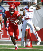 Houston wide receiver Marquez Stevenson, left, runs for a touchdown during the first half of an NCAA college football game against Arizona, Saturday, Sept. 8, 2018, in Houston. (AP Photo/Eric Christian Smith)