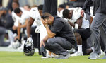 FILE - In this Nov. 23, 2018, file photo, members of the Central Florida staff and players react while quarterback McKenzie Milton receives attention for an apparent knee injury during the first half of an NCAA college football game against South Florida, in Tampa, Fla. The seventh-ranked Knights (11-0, 8-0, No. 8 CFP) are one victory away from their second straight American Athletic Conference championship, a likely New Year's Six bowl bid and bolstering their argument that they are deserving of consideration for a berth in the College Football Playoff. None of that is possible, though, without beating Memphis (8-4, 5-3) in Saturday's AAC title game. UCF will be playing without Milton, the two-time AAC offensive player of the year. (AP Photo/Mike Carlson, File)
