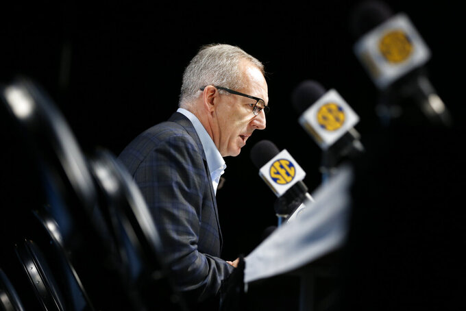 FILE - In this March 12, 2020, file photo,  Greg Sankey, commissioner of the Southeastern Conference, talks about the decision to cancel the remaining games in the SEC NCAA college basketball tournament, in Nashville, Tenn.  College sports leaders have repeatedly said there can be no college sports without campuses being open to students. And those decisions will be made with guidance from state and local public health and government officials. (AP Photo/Mark Humphrey, File)