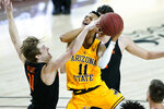 Arizona State guard Alonzo Verge Jr. (11) is fouled by Oregon State guard Zach Reichle (11) during the second half of an NCAA college basketball game, Sunday, Feb. 14, 2021, in Tempe, Ariz.(AP Photo/Matt York)
