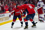 Washington Capitals right wing T.J. Oshie, left, celebrates with left wing Alex Ovechkin after Oshie's goal against the New York Rangers during the first period of an NHL hockey game Wednesday, Oct. 13, 2021, in Washington. (AP Photo/Alex Brandon)
