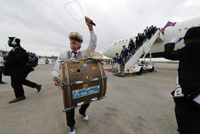 The 3rd Line Brass Band performs as Clemson arrives in New Orleans for the NCAA College Football Playoff title game, Friday, Jan. 10, 2020. Clemson is scheduled to play LSU on Monday. (AP Photo/Gerald Herbert)