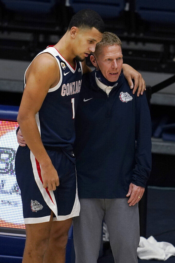 Gonzaga guard Jalen Suggs stands next to coach Mark Few during the second half of the team's NCAA college basketball game against Saint Mary's in Moraga, Calif., Saturday, Jan. 16, 2021. (AP Photo/Jeff Chiu)