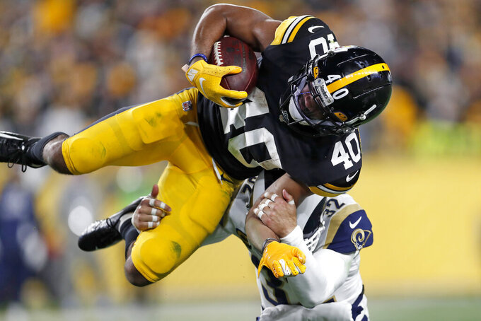 Los Angeles Rams free safety Eric Weddle (32) tackles Pittsburgh Steelers running back Tony Brooks-James (40) during the second half of an NFL football game in Pittsburgh, Sunday, Nov. 10, 2019. (AP Photo/Keith Srakocic)