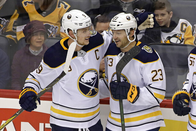 Buffalo Sabres' Sam Reinhart (23) celebrates his goal with Jack Eichel (9) during the first period of the team's NHL hockey game against the Pittsburgh Penguins in Pittsburgh, Saturday, Feb. 22, 2020. (AP Photo/Gene J. Puskar)