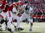 Rutgers quarterback Johnny Langan is tackled by Michigan State linebacker Noah Harvey (45) during the first half of an NCAA college football game Saturday, Nov. 23, 2019, in Piscataway, N.J. (AP Photo/Adam Hunger)