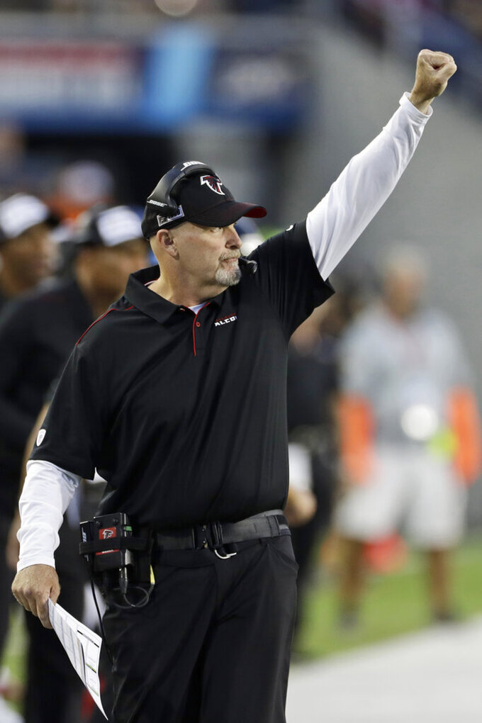 Atlanta Falcons coach Dan Quinn gives a signal during the first half of the team's Pro Football Hall of Fame NFL preseason game against the Denver Broncos, Thursday, Aug. 1, 2019, in Canton, Ohio. (AP Photo/Ron Schwane)