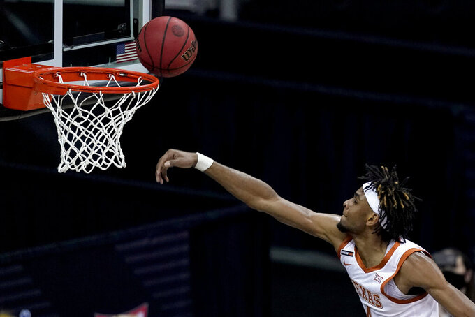 Texas's Greg Brown puts up a shot during the first half of an NCAA college basketball game against Oklahoma State for the Big 12 tournament championship in Kansas City, Mo, Saturday, March 13, 2021. (AP Photo/Charlie Riedel)
