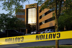 FILE - In this June 29, 2018, file photo, crime scene tape surrounds a building housing The Capital Gazette newspaper's offices, in Annapolis, Md. A pool of 300 potential jurors will be in a Maryland court on Friday, Sept. 27, 2019, to answer questions about the mass shooting at the Capital Gazette newspaper that killed five people last year. Judge Laura Ripken has scheduled three days of jury selection beginning Oct. 30. (AP Photo/Patrick Semansky, File)