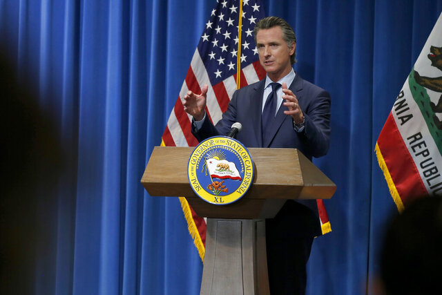 California Gov. Gavin Newsom discusses his revised 2020-2021 state budget during a news conference in Sacramento, Calif., Thursday, May 14, 2020. (AP Photo/Rich Pedroncelli, Pool)