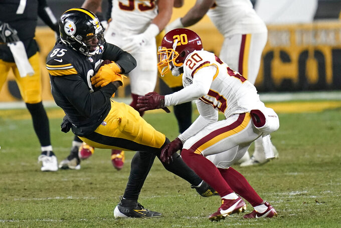 Pittsburgh Steelers tight end Eric Ebron (85) comes down with a pass with Washington Football Team cornerback Jimmy Moreland (20) defending during the second half of an NFL football game, Monday, Dec. 7, 2020, in Pittsburgh. (AP Photo/Keith Srakocic)