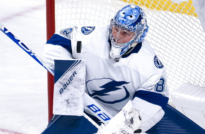 Tampa Bay Lightning goaltender Andrei Vasilevskiy blocks a Montreal Canadiens shot during the second period of an NHL hockey game Tuesday, Oct. 15, 2019, in Montreal. (Paul Chiasson/The Canadian Press via AP)