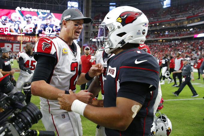Atlanta Falcons quarterback Matt Ryan (2) greets Arizona Cardinals quarterback Kyler Murray (1) after an NFL football game, Sunday, Oct. 13, 2019, in Glendale, Ariz. The Cardinals won 34-33. (AP Photo/Ross D. Franklin)