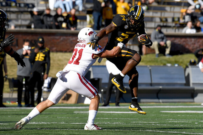 Missouri running back Larry Rountree III, right, runs with the ball as Arkansas linebacker Grant Morgan (31) defends during the second half of an NCAA college football game Saturday, Dec. 5, 2020, in Columbia, Mo. (AP Photo/L.G. Patterson)